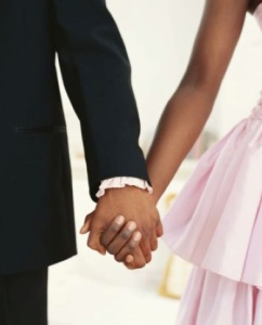 brideandgroomholdinghands